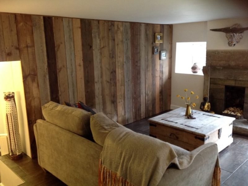 living room with rustic wall cladding