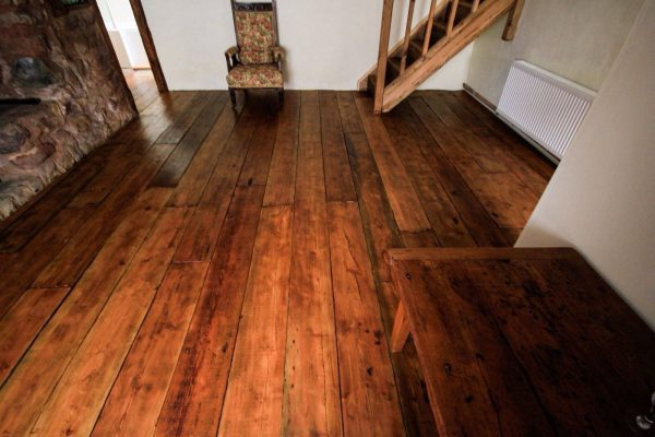 waxed reclaimed rustic floorboards