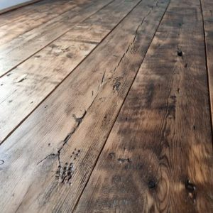 Reclaimed Floorboards In A Small Room